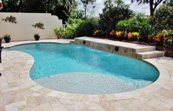 backyard swimming pool with waterfall