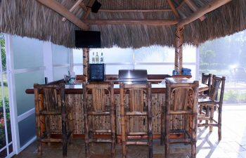 tiki hut with a pool bar and stools