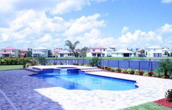 backyard swimming pool with interlocking brick paver deck