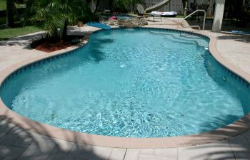 backyard swimming pool with paver deck