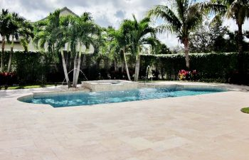 backyard swimming pool with jacuzzi and two fountains after renovation