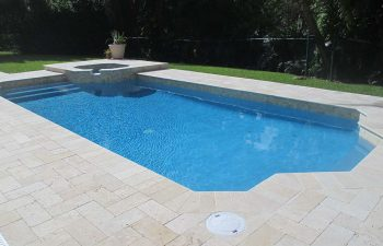 backyard swimming pool with jacuzzi and pool deck after renovation