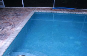 indoor swimming pool and deck before renovation