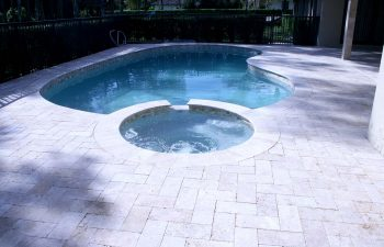 backyard pools and jacuzzi with light blue water color