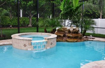 spa pools with a hardscape waterfall