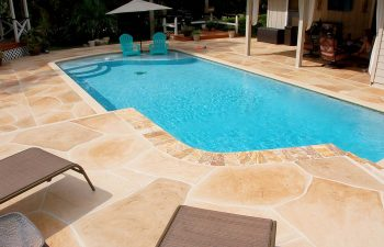backyard swimming pool with flagstone deck