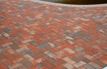 Interlocking brick paver pool deck