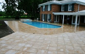 Backyard Swimming Pool With Artistic Pavers Deck