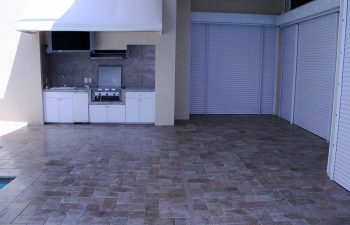 paver patio with an outdoor kitchen