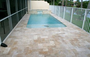 swimming pool with artistic pavers deck