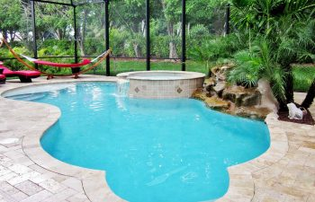 glass enclosed spa pools with hardscape waterfall