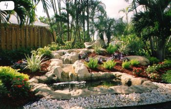 hardscape waterfall in a landscaped garden