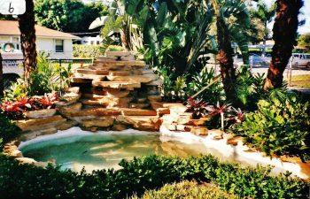 hardscape waterfall in a landscaped backyard