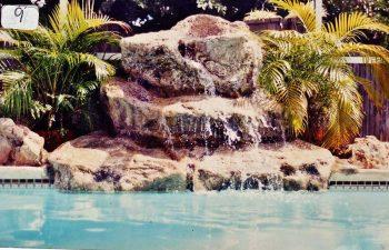 backyard swimming pool with a hardscape waterfall