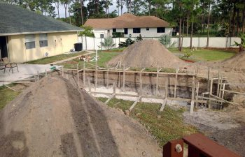 backyard swimming pool under construction - preparing excavation