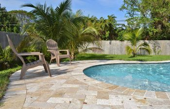 backyard swimming pool with Travertine deck