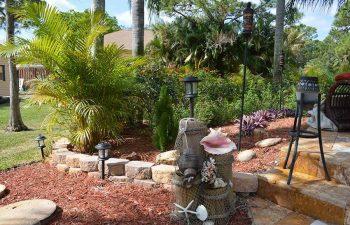 landscaped backyard with hardscape