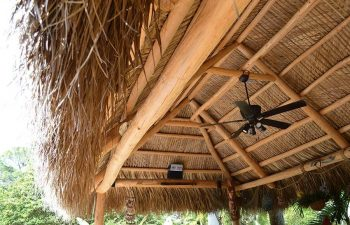 outdoor lighting installed under a tiki hut roof