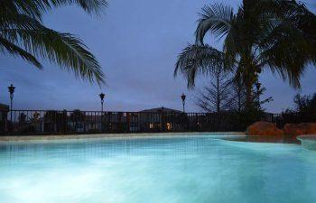 night view of a bakyard swimming pool