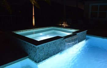 night view of outdoor spa pools with lighting