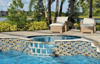 two sun longers on a backyard swimming pool patio