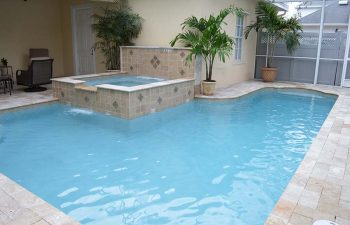 indoor spa pools with waterfalls and decorative tiles