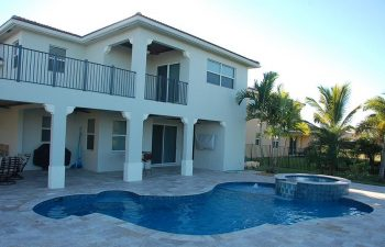 backyard swimming pool with jacuzzi and paver deck