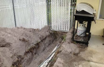 backyard swimming pool under construction - lying pipe system
