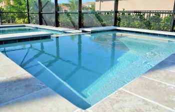 glass enclosed pools with light blue water color