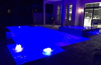 night view of a patio with spa pools