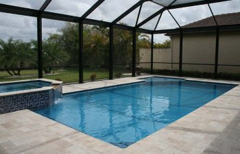 glass enclosed swimming pool and jacuzzi