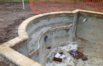 backyard swimming pool under construction
