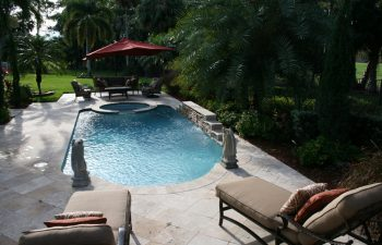 landscaped garden with a swimming pool and outdoor furniture on a deck
