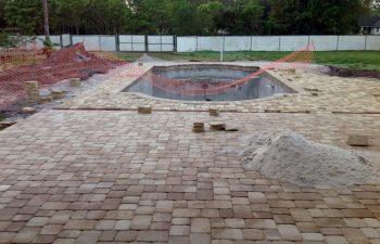 backyard swimming pool under construction - lying deck