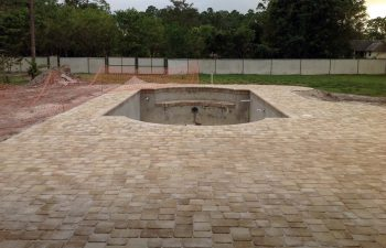 backyard swimming pool under construction - final stage