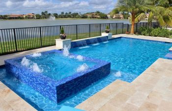 backyard swimming pool with and jacuzzi and built-in waterfall and fountains