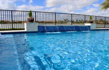 backyard swimming pool with built-in waterfall