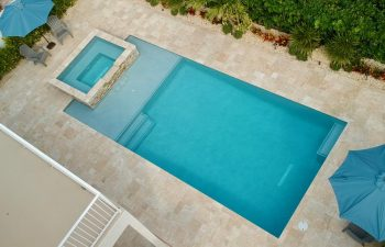 aerial view of backyard swimming pool with jacuzzi