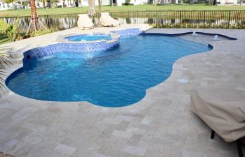 backyard swimming pool with built-in fountains and waterfalls