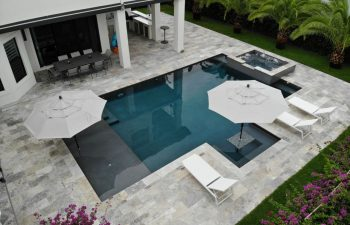 backyard swimming pool with jacuzzi and artistic pavers patio