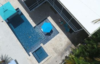 aerial view of a modern backyard swimming pool with jacuzzi