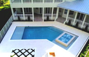 modern backyard swimming pool with jacuzzi