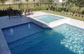 swimming pool with jacuzzi and built-in fountains