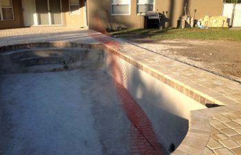 backyard swimming pool under construction