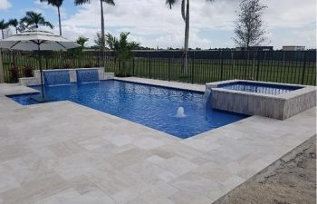 modern backyard swimming pool with jacuzzi and water features