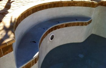 backyard swimming pool under construction - installed vinyl liner