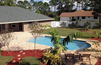 finished backyard swimming pool with paver deck