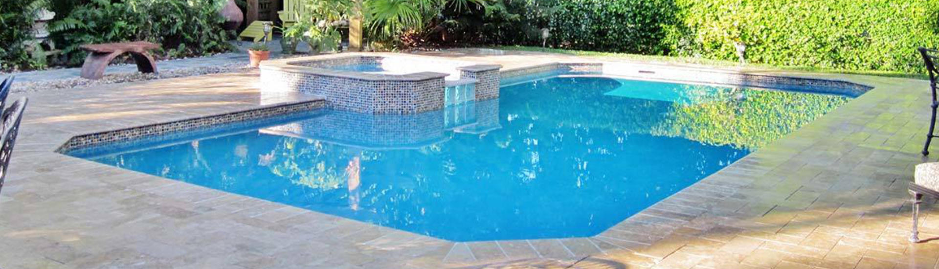 backyard swimming pool with and jacuzzi and paver deck